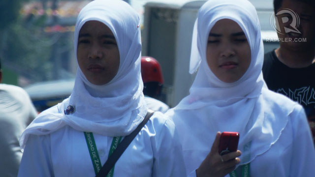 RELIGIOUS FREEDOM. Muslim women on the streets of Zamboanga City. Photo by Amir Mawallil