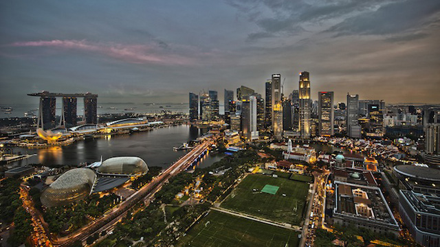 Singapore skyline at dusk, June 3, 2011. Photo courtesy of Wikipedia/chensiyuan