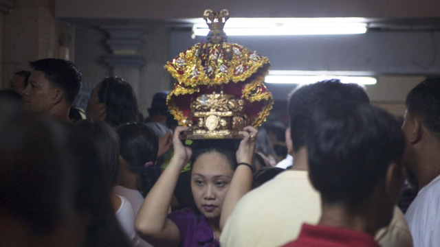 ALL SET. A lady waits inside the Basilica del Sto. Niño before the procession begins. Photo by Jon Cabiles