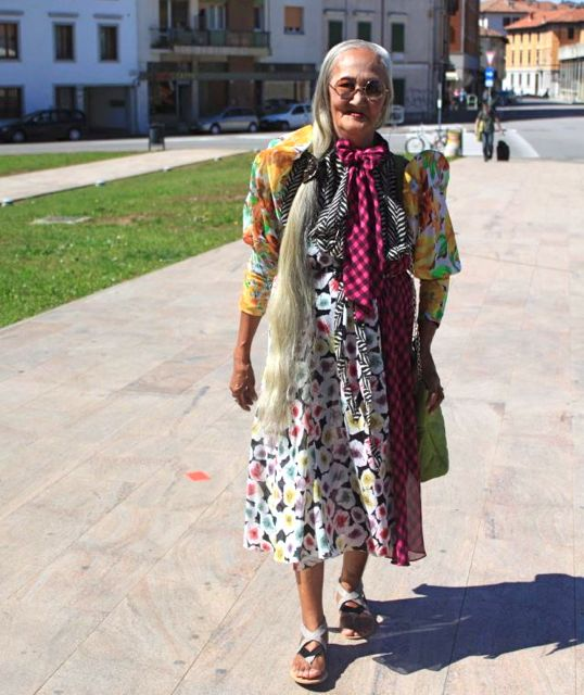 CLASHING PRINTS. Lilia Cuntapay pulls of a Vivienne Westwood-ish get-up in Udine, Italy. Image from the movie's Facebook page