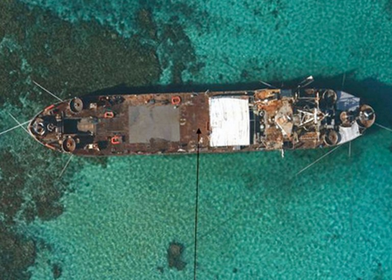 SEA BASTION. This undated handout photo released by the Philippine government on May 23, 2013 shows an aerial view of BRP Sierra Madre, a 100-meter (328 foot) amphibious vessel built for the US in 1944 and acquired by the Filipino navy in 1976, grounded at Second Thomas Shoal in the Spratly Islands. AFP Photo/Philippine Government