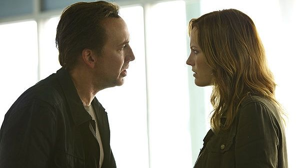 PRETTY PERSUASION. Nicolas Cage tries to convince Malin Ackerman that being in Stolen is a good idea. All images from the movie's Facebook page
