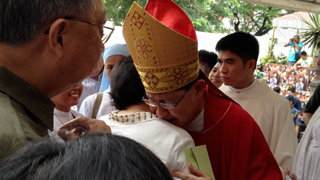IN TEARS. Manila Archbishop Luis Antonio Tagle cries as he hugs a friend who congratulated him, after a Mass in honor of St Pedro Calungsod last November 7. Photo by Paterno Esmaquel II
