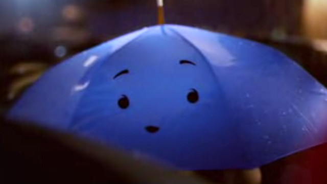 LOVE IN THE RAIN. 'The Blue Umbrella' is directed by Saschka Unseld with original score by Jon Brion. Screen grab from YouTube (WSJDigitalNetwork)