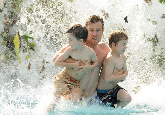 FATHER IN HELL. Ewan McGregor, with Oaklee Pendergast (left) and Samuel Joslin, runs for cover