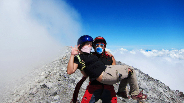 LOVE LIFTS YOU UP. Gregg Yan and Mo Francisco on the summit of Mt. Mayon. All photos courtesy of Gregg Yan