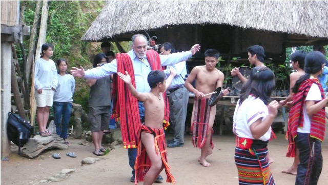 PHILIPPINE TOURISM. A foreigner joins an Igorot community dance. Photo taken from the National Tourism Development Plan.