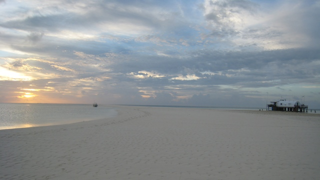 PARADISE ON EARTH. In this sunset view from the sandbar with the rangers detachment in the background. Photo by Anais Thoret