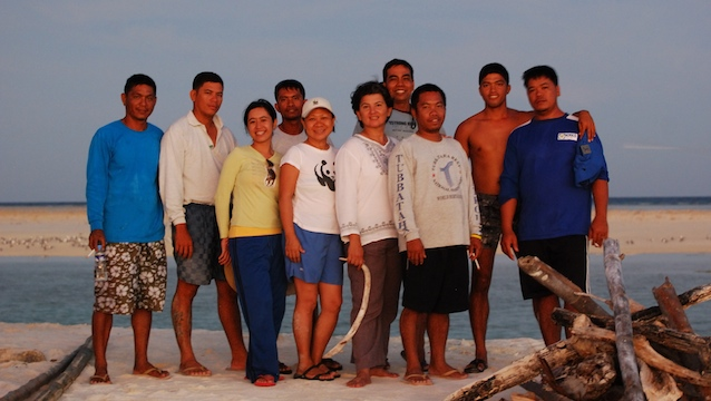 PARK RANGERS. Angelique Songco (center) with her staff at the Tubbataha Reefs Natural Park. Photo courtesy of Angelique Songco