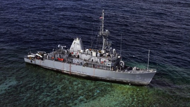 WAITING TO BE DISMANTLED. The mine countermeasures ship USS Guardian (MCM 5) sits aground Tuesday, January 22, 2013 on the Tubbataha Reef in the Sulu Sea. AFP PHOTO / US NAVY