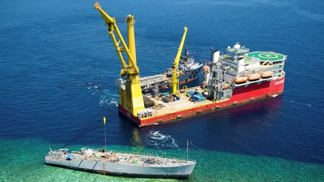 SALVAGE SITE. Aerial view of the Jascon 25 crane ship and Archon Tide tugboat beside the USS Guardian on March 12, 2013. Photo by US Navy