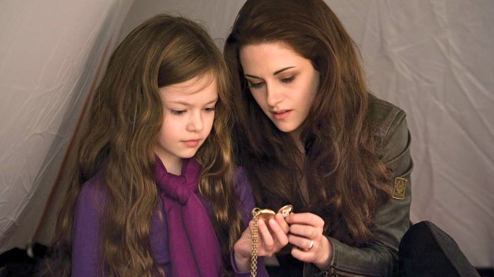 BORN, NOT BITTEN. Renesmee (Mackenzie Foy) with mom Bella (Kristen Stewart) in a scene from 'Breaking Dawn' part 2. Image from the movie's Facebook page