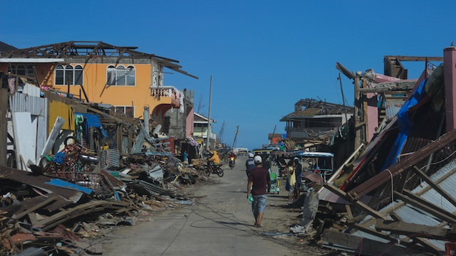 AFTER THE STORM. Wreckage from typhoon Pablo lines the streets. Photo by Karlos Manlupig
