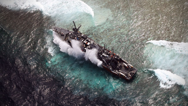 STILL STUCK. Philippine Air Force aerial image of the USS Guardian near the upper side of Tubbataha's South Atoll. Photo courtesy of AFP Wescom