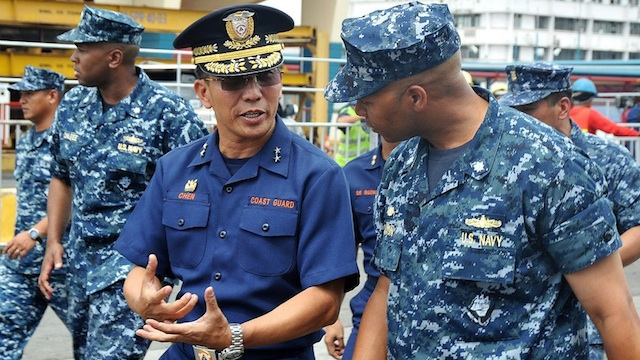 "Rear Admiral Cecil R. Chen (L), commander of Philippine Coast Guard District National Capital Region - Central Luzon, speaks with Cmdr. Thomas ""T.J."" Dixon, commanding officer of the Arleigh Burke-class guided-missile destroyer USS McCampbell (DDG 85). Photo courtesy of US Embassy in Manila"
