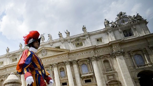 HEADACHE. A Swiss guard walks outside the St Peter's Basilica in this file photo