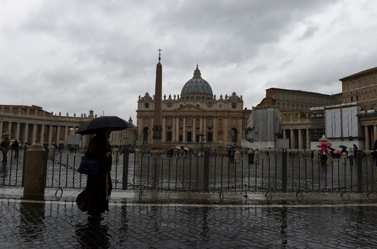 A monk walks on St Peter's square on March 6, 2013 at the Vatican. AFP PHOTO / VINCENZO PINTO