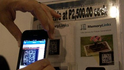 MEMORIES IN A CODE. Scanning a QR code of a deceased brings his world back to life