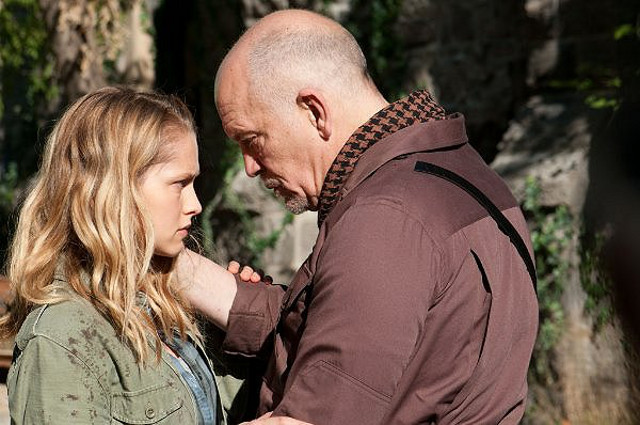 BAD DAD. John Malkovich, with Teresa Palmer, gets parental in 'Warm Bodies.' Photo by Summit Entertainment