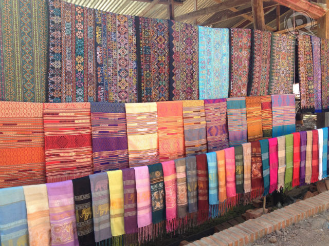 CULTURAL THREADS. Laos traditional textile on display at a village stall. All photos by Zak Yuson