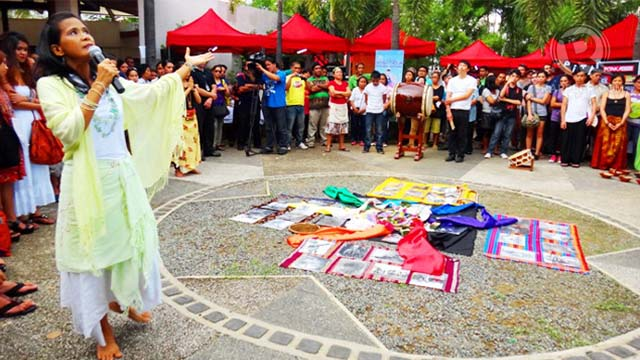 Leah Tolentino leads a breathing and peace meditation at the Earth Dance Festival, a global peace event also celebrated in the Philippines