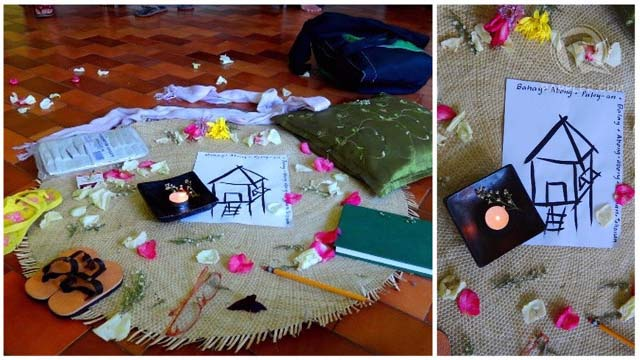 (Left) Objects laid out by workshop participants to represent the journey of 'coming home to one's true self.' The drawing of the house in the middle is surrounded by the word 'home' in different Filipino languages. (Right) Close-up of the house drawing.