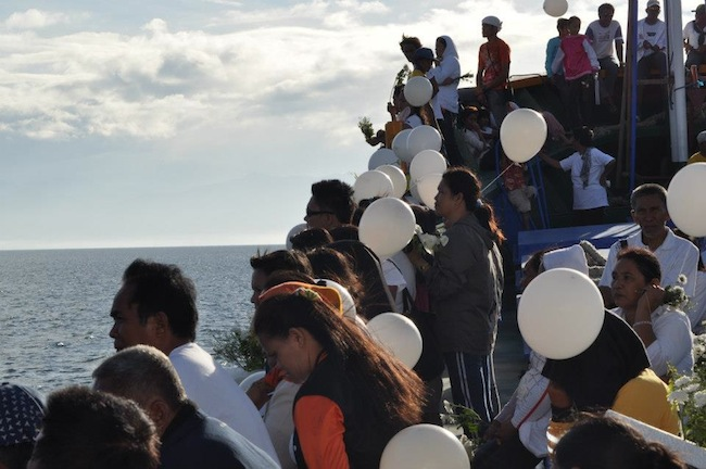 Families of fishermen lost at sea during typhoon Pablo (Bopha) prepare to release white balloons in honor of the victims, aboard a ship in waters off General Santos City, January 19, 2013. Photo by Francis Canlas.