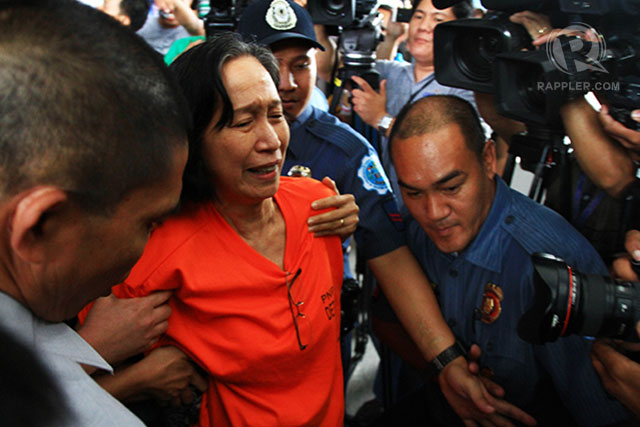 """ARRESTED. Wilma Tiamzon leaves the PNP Multipurpose Center after they protest the """"highly irregular"""" inquest proceedings against the Tiamzons and 5 others. Photo by Ben Nabong/Rappler"""