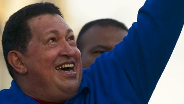 SWORN IN FROM CUBA? Venezuelan President Hugo Chavez greets supporters during a campaign rally in Monagas on September 28, 2012. AFP PHOTO/JUAN BARRETO