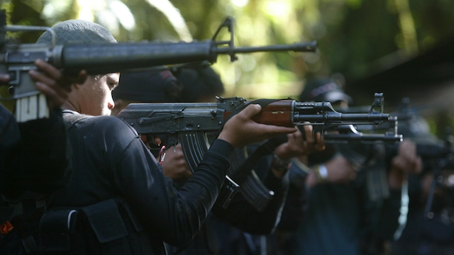 ARMED. Philippine communist rebels have been fighting the government since 1968. Photo by Keith Bacongco