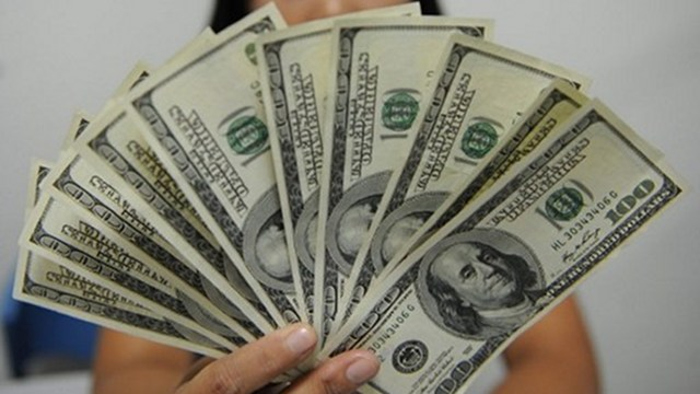 OFW MONEY. The Philippines is the third-biggest recipient of dollar remittances in the world. Photo from AFP