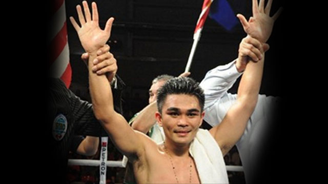 "VICTORIOUS. Philippine boxer Brian ""Hawaiian Punch"" Viloria beat Mexican Hernan ""Tyson"" Marquez on Sunday, November 17. Photo by AFP"