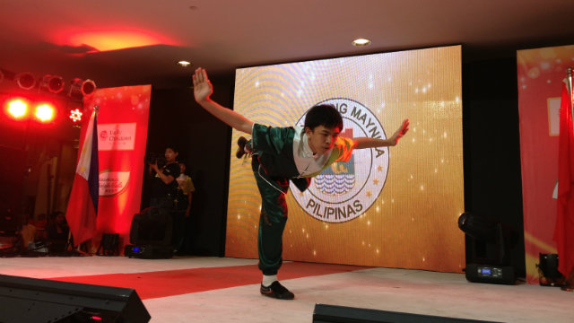 BALANCING ACT. A member of the Philippine Buddhacare Academy shows off his skill on stage
