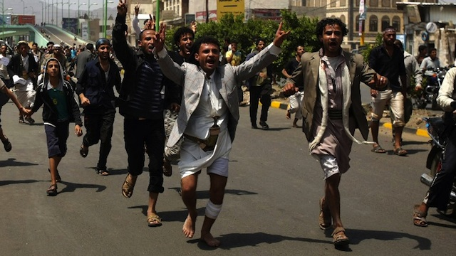 MUSLIM WRATH. Yemeni protesters shout slogans during a protest against a film deemed insulting to the Prophet Mohammed, in Sanaa on September 13, 2012. AFP PHOTO/ MOHAMMED HUWAIS