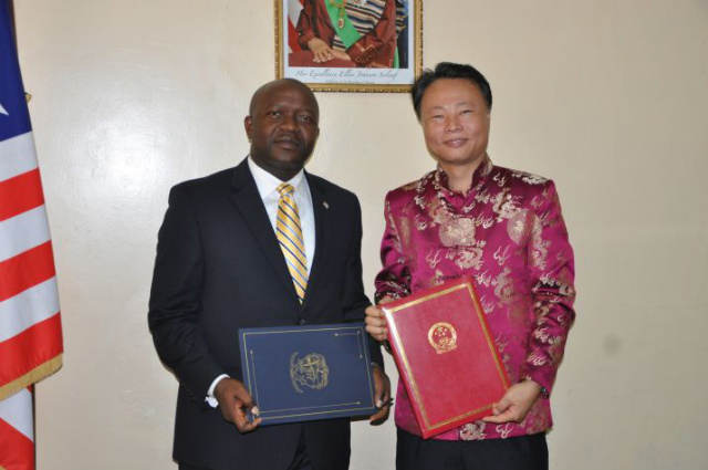 FROM LIBERIA TO PH. Zhao Jianhua (right), then China's ambassador to Liberia, poses after signing an agreement with the Liberian Foreign Minister Augustine Kpehe Ngafuan (left). File photo courtesy of the Liberian Foreign Ministry