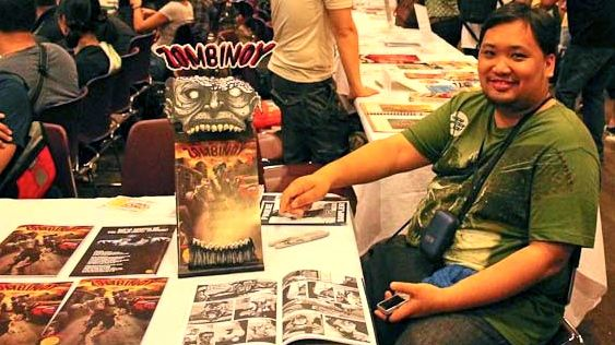 PENCIL PUSHER. 'Zombinoy' penciler Carlo Cruz hangs back at Summer Komikon 2012