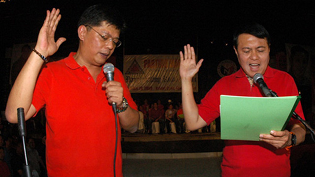 PARTY BUILDING. The NP fights it out in local free zones but works with the ruling party in the legislature. In photo: Cavite Rep Boying Remulla (left) and NP head Sen Manny Villar