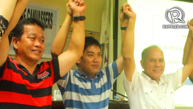 NEW BLOOD. Proclamation of newly-elected Olongapo Vice Mayor Rodel Cerezo (left), with Comelec supervisor Atty. Dictador Untayao and Olongapo City Mayor-Elect Rolen Paulino (right). Photo by Randy Datu