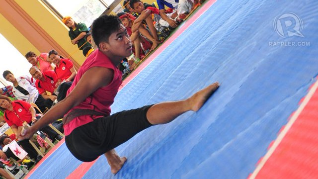 TIGERS. Regie Jet Sanches, this year's silver medal for likha anyo double weapon category (secondary boys division), used eyeliner during his performance. Loj Guinmapang