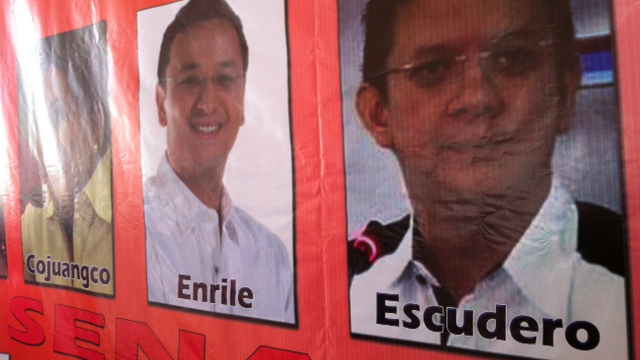 "PICTURE TROUBLE. Quimbo's photo was spotted under the name ""Enrile"" in the poster that featured UNA's top leaders and Senate bets. Photo by Ayee Macaraig."