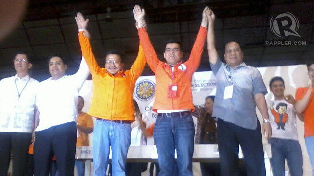 ERAP AND ISKO. Joseph Estrada and Franciso Domagoso raise their hands in triumph. Photo by Jerald Uy