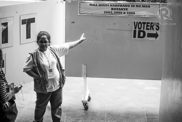 THIS WAY, PLEASE. Bold signs for voters who forgot to get IDs. All photos by Leah A. Valle/RAPPLER