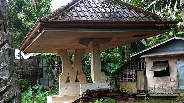 M and T. Waiting sheds along the national highway in Samar carry the initials of the Tan matriarch, Milagrosa. Photo by Judith Balea