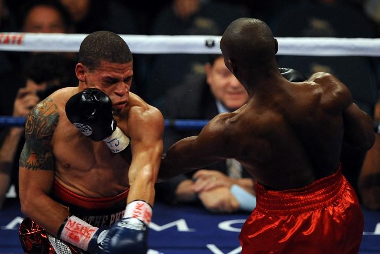 TOUGH AS NAILS. Cornelius Lock of the US (R) bouts Orlando Cruz of