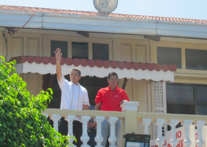 BACK IN CITY HALL. Mayor Homer Saquilayan, with Gov. Jonvic Remulla, at the balcony of Imus city hall. Photo by Mark Libanan