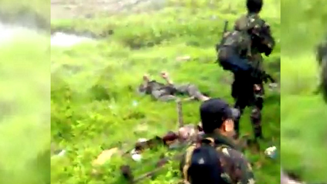 Screenshot of video of alleged soldiers involved in summary execution