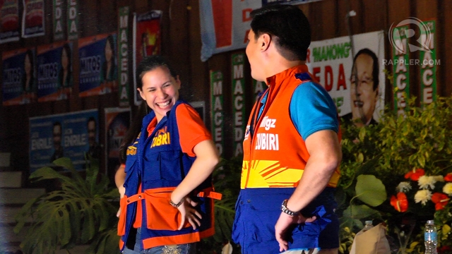 """DANCE DUO. Audrey Zubiri joins husband Migz Zubiri on the campaign trail, dancing """"Gangnam Style"""" in a Baguio sortie of the opposition United Nationalist Alliance. RAPPLER/Franz Lopez"""