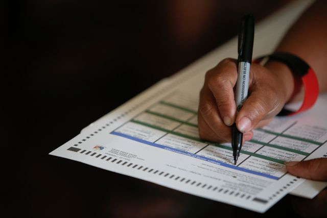 SAMPLE BALLOT. A voter practices shading the ballot during this year's mock elections. File photo by John Javellana