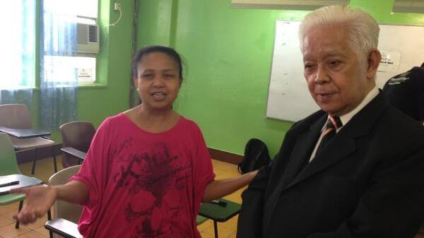 FIRST DAY. Comelec chair Sixto Brillantes Jr with the first voter in Hong Kong to cast her vote for the 2013 elections. Photo from Brillantes' Twitter account