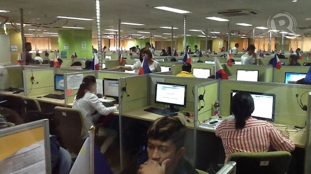ALL SET. Agents at the National Support Center (NSC) work at their desks on Saturday, May 11, in preparation for the elections. Rappler/Dean Lozarie